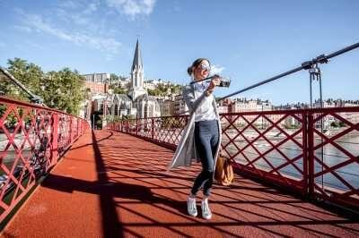 woman on a bridge in lyon