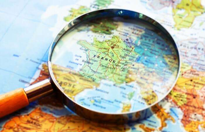 Magnifying glass on a map of France