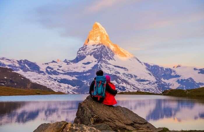 couple admiring Swiss Alps
