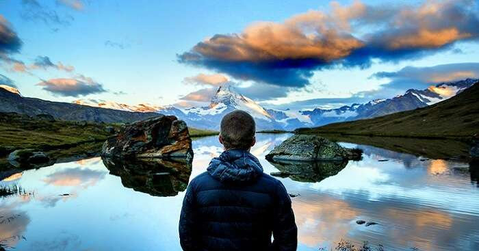 person looking at the lake in switzerland