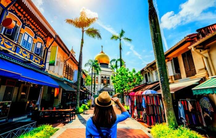 woman holding a hat near famous market