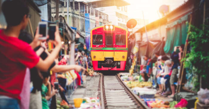 A train in Thailand passing through the market