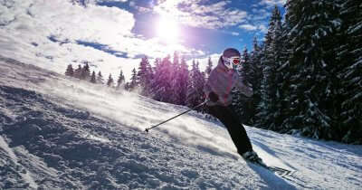A person skiing on the icy slope of a mountain