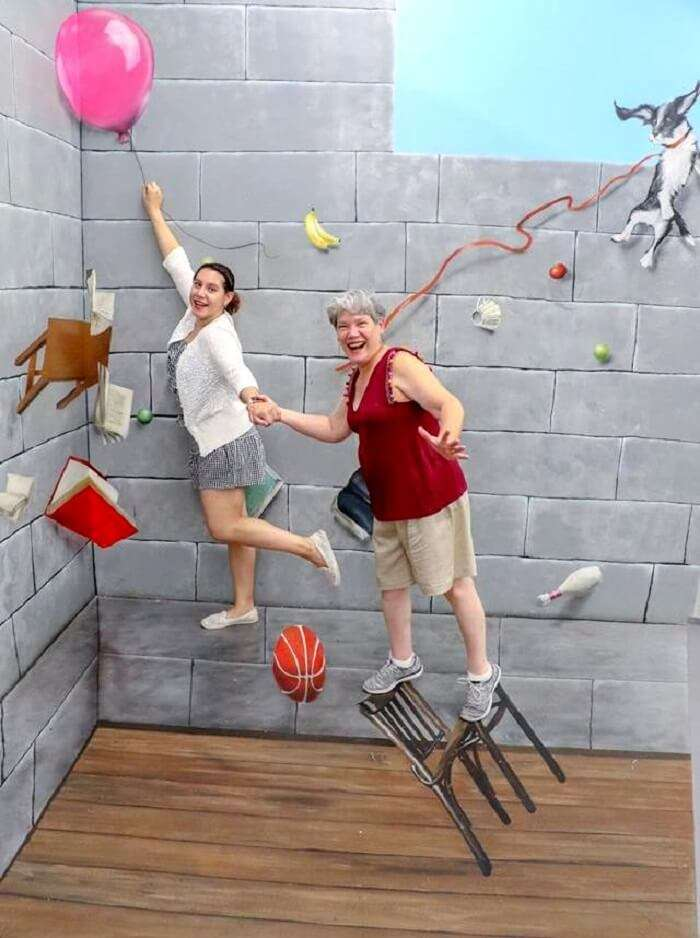 People enjoying at the museum of illusions