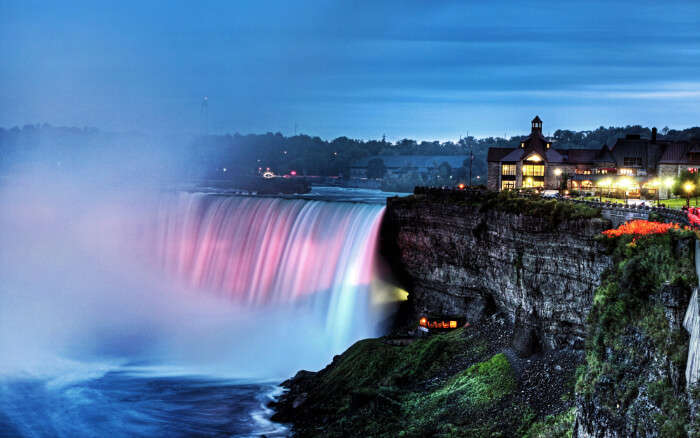 A colourful night view of Niagara Falls In Canada
