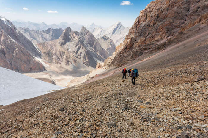 People trekking in Pamir Mountains