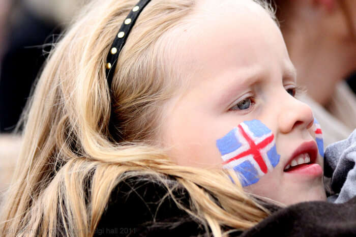 A girl flaunting Iceland National flag on her cheeks