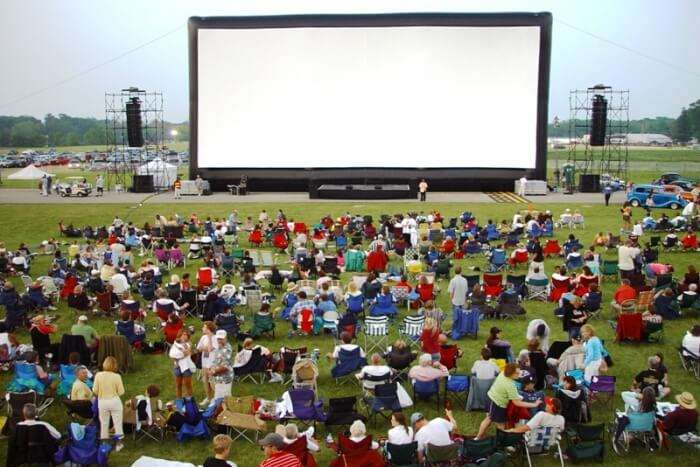 Watch a movie under the shining stars and blue sky