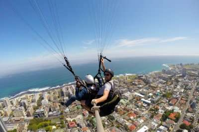 man paragliding in sky