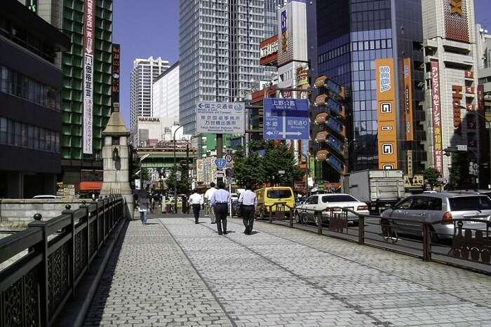 people walking across the road in Akihabara