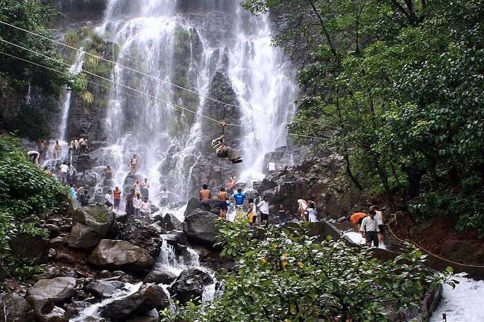 people visiting waterfall