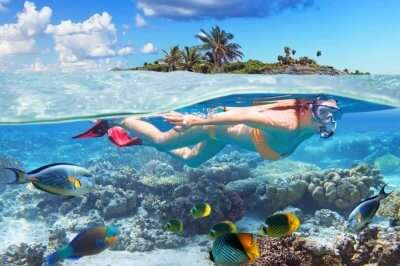 A woman snorkeling in Bahamas