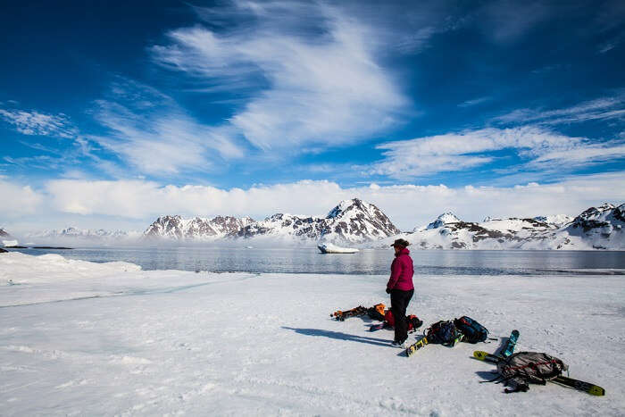 person stepping on the ice in greenland