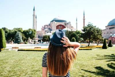 woman looking at the famous mosque in Istanbul