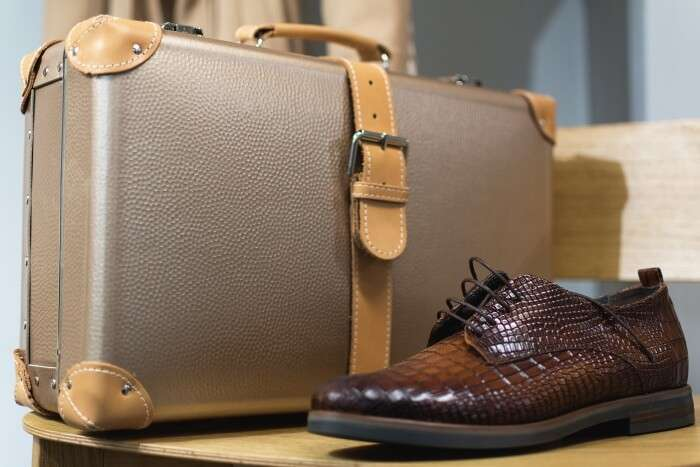 Men's leather boots and suitcase