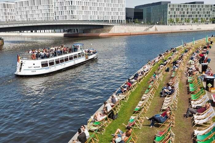 people sitting by beach in berlin