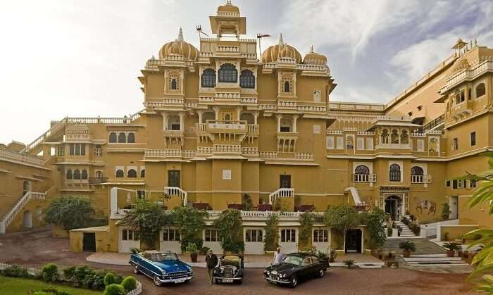 vintage cars outside deogarh palace
