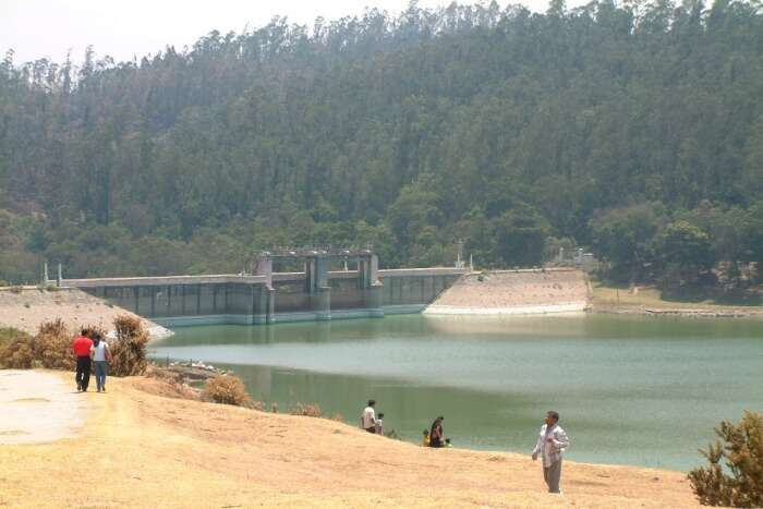 People standing near the dam