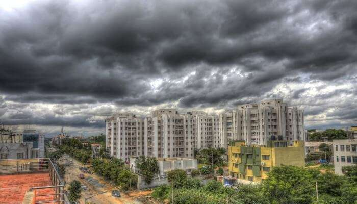 clouds over modern buildings