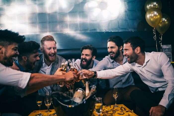 boys cheering in a club