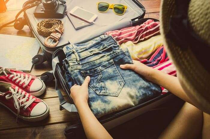 A traveler packing for a vacation