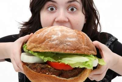 woman eating giant burger