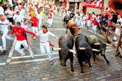 people running with bulls in spain