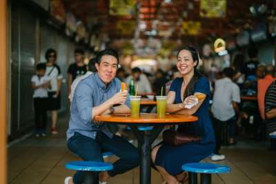 An Asian couple drinking in a cafe in Singapore