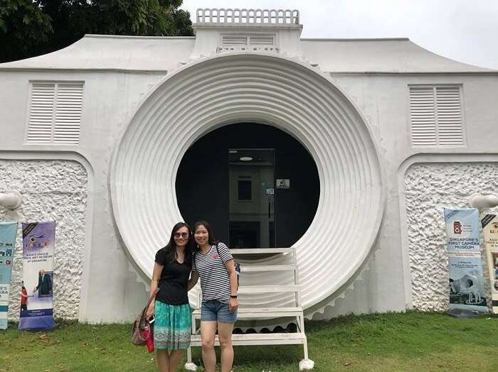 Tourists posing at the Vintage Camera Museum