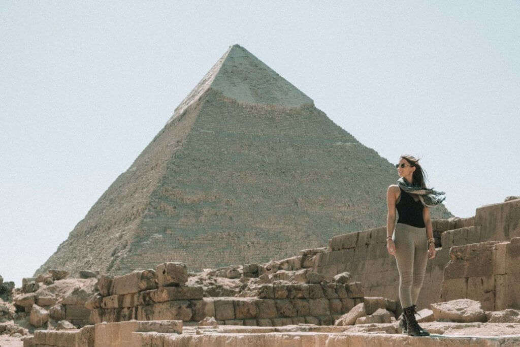 Lexie Alford posing in front of a pyramid in Egypt