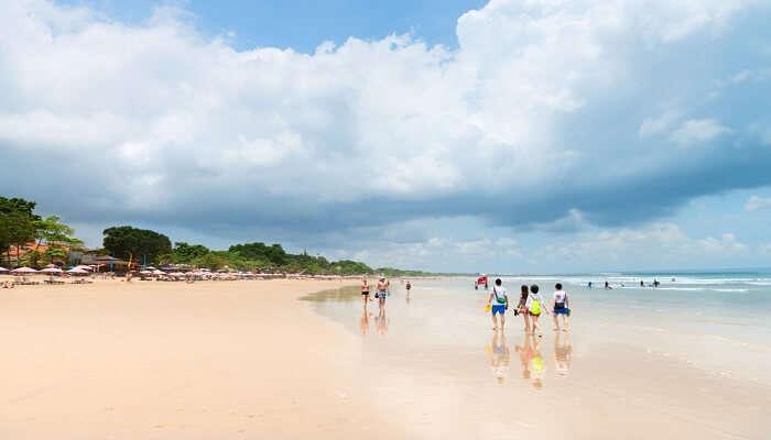 people walking at the beach in Bali