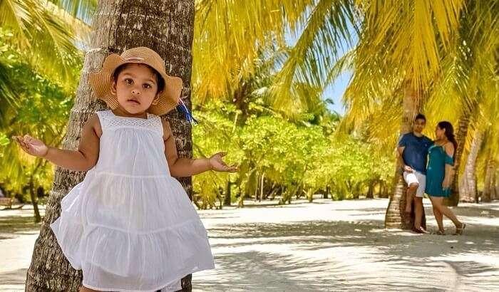 Standing near coconut palm tree