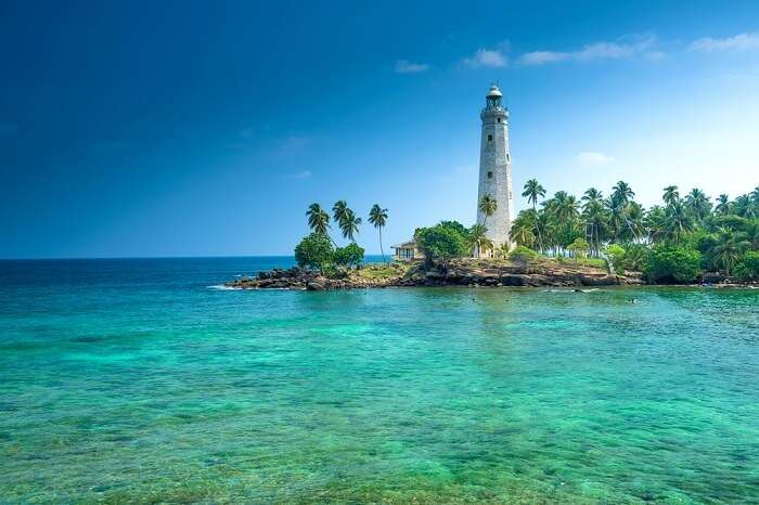 gorgeous view of the beach and lighthouse