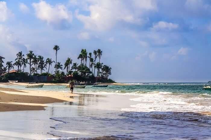 traveler on beach in sri lanka