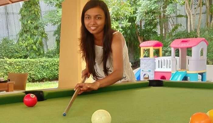 playing pool in resort