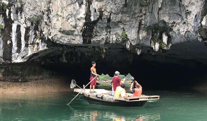 explore the limestone caves at Halong Bay