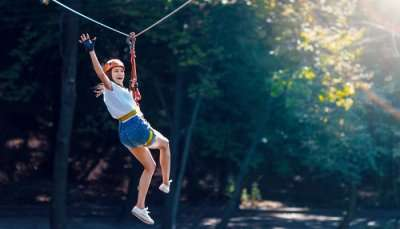 a girl ziplining in karnataka