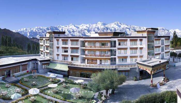hotel building with mountains at the backdrop
