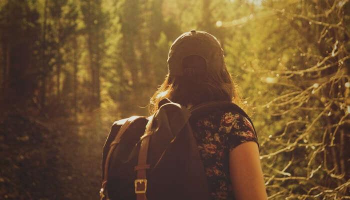A girl trekking through the forest