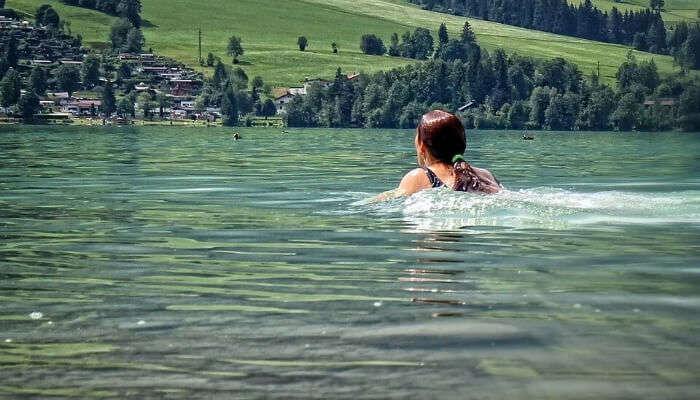 Enjoying Swimming in Lake