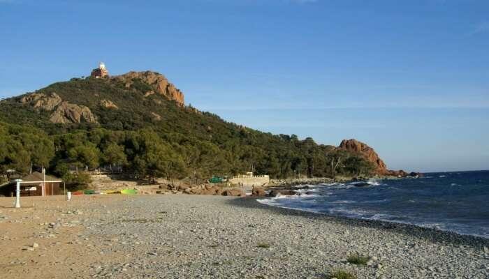 green mountain and beach