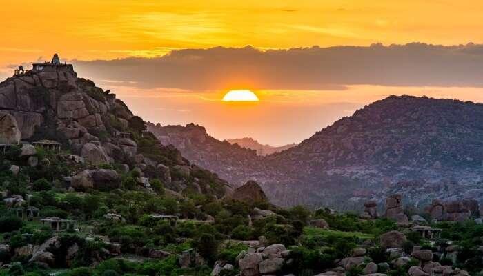 sun setting behind the ruins