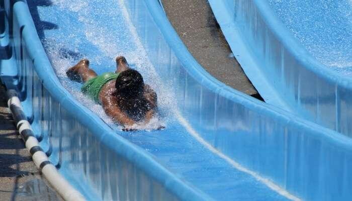 kid sliding down the waterslide