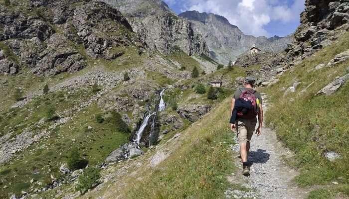man trekking amidst mountains