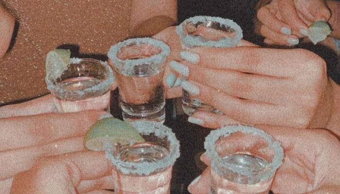having shots of drink