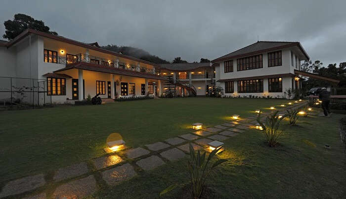 resort surrounded by lush green valley