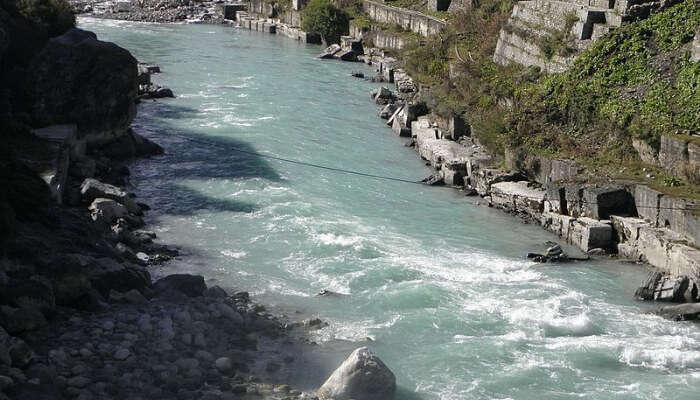 River Flowing Between Hills